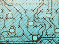 stock image of  Circuit board made of plastic with circuit traces on blue background. The concept of technology, computing, electronics