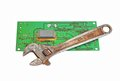 Circuit board and wrench Royalty Free Stock Photography