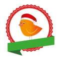 Circular emblem with ribbon and bird with christmas hat