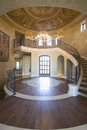 Circular entrance hallway and staircase with handrail at spacious house Stock Image