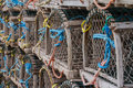 Circular lobster traps a group of sit on a wharf harbours edge Stock Images