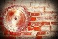 Circular saw blade on a grungy brick wall. Royalty Free Stock Photo