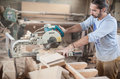 Circular saw carpenter using for wood Royalty Free Stock Photo
