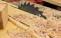 Circular saw and sawdust in workshop Royalty Free Stock Photo