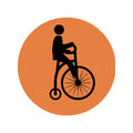 Circular silhouette with man in penny farthing Royalty Free Stock Photo