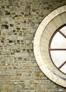 The circular window on a stone wall Stock Photography
