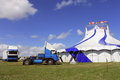 Circus big top tent and trucks in field Stock Photos