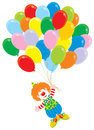 Circus clown flies with balloons Stock Photos