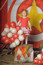 The circus girl shot of little cute with multicolored air balloons Stock Images