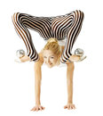 Circus gymnast woman flexible body standing on arms upside down balancing balls feet isolated white background Royalty Free Stock Images