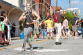 Circus performers entertain people at atlanta street festival ga usa may with the imperial opa patrons walking by the fire in the Royalty Free Stock Photo