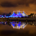 Circus style blue tent at night big top and row of lights on the bank of corrib river in galway ireland Stock Photography