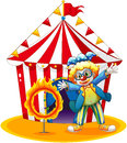 A circus tent at the back of the clown with a ring of fire illustration on white background Royalty Free Stock Images