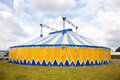 Circus tent in yellow and blue the grass Stock Photo