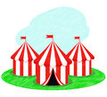 Circus tents placed on a green field Royalty Free Stock Photo