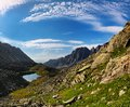 Cirrus clouds over the mountain tundra in eastern siberia Stock Photos