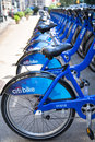 Citibike nyc new york city aug row of citi bike bicycles in midtown manhattan on aug this bicycle sharing system serving new york Royalty Free Stock Photo
