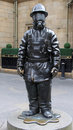 Citizen firefighter bronze sculpture glasgow a gordon street scotland is by kenny hunter and was commissioned by strathclyde fire Royalty Free Stock Photography