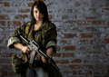 Citizen soldier armed and ready to put up a fight this beautiful young woman has grabed her weapon and is ready to join the front Royalty Free Stock Images