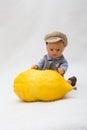 Citron - etrog  with doll child Royalty Free Stock Photo