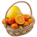 Citrous fruits in basket Stock Photo