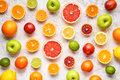 Citrus colorful fruits background mix flat lay, summer healthy vegetarian vitamin food Royalty Free Stock Photo