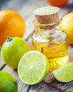 Citrus essential oil and slice of orange, lemon and lime fruits Royalty Free Stock Photo