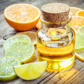 Citrus essential oil and slice of ripe fruits: orange, lemon and Royalty Free Stock Photo