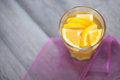 Citrus flavour tea hot served with orange and lemon slices full of spices winter time drink on violet tablecloth Royalty Free Stock Image