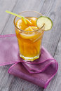 Citrus flavour tea hot served with orange and lemon slices full of spices winter time drink on violet tablecloth Royalty Free Stock Photography