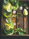 Citrus fruit and herbs infused sassi water in wooden tray Royalty Free Stock Photo