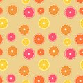Citrus fruit slices seamless/repeat pattern. Differently colored slices on light beige.