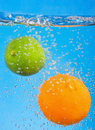 Citrus fruits fall into the water Stock Photography
