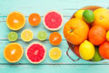 Citrus fruits in retro colander oranges tangerines lemons grapefruits and lime Stock Photography