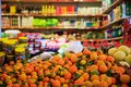 Citrus fruits in row. Blurred products in market store. Close up view. Royalty Free Stock Photo