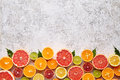 Citrus fruits vegan mix flat lay on white background, helthy vegetarian organic food Royalty Free Stock Photo