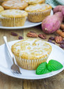 Citrus glazed sweet potato muffins with pecan nuts and raisins Stock Photography