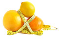 Citrus and measure tape on white Royalty Free Stock Image