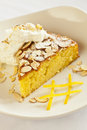 Citrus olive oil cake topped with almonds and whipped crème Stock Images
