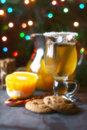 Citrus punch in the glass on the dark table with Christmas decorations Royalty Free Stock Photo