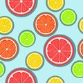 Citrus seamless pattern. Green, red and yellow citrus slices on a blue background. Fruit picking. Vector background EPS 8 Royalty Free Stock Photo