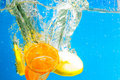 Citrus slice SPLASHING IN WATER Royalty Free Stock Photos