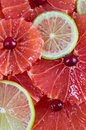 Citrus slices background grapefruit and lime vertical Royalty Free Stock Photos