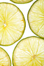 Citrus slices fresh fruit background yellow green Royalty Free Stock Images