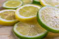 Citrus slices lemon and lime image of on a wooden background Royalty Free Stock Photography