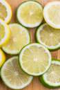Citrus slices lemon and lime image of on a wooden background Stock Photography