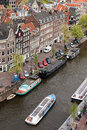 City of amsterdam from above prinsengracht street cruise boat and houseboats on a canal holland the netherlands Royalty Free Stock Photography