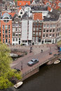 City of amsterdam cityscape from above historic terraced houses and bridge over canal in north holland the netherlands Stock Photo
