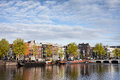 City of amsterdam river view cityscape terraced houses along amstel in holland the netherlands Royalty Free Stock Images