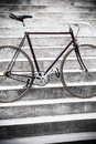City bicycle and concrete stairs vintage style fixed gear Royalty Free Stock Images